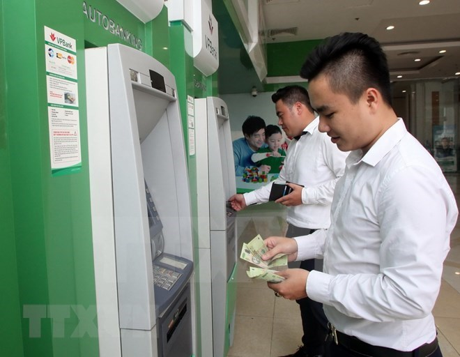 Banks make great strides in technology application.(Photo: VNA)