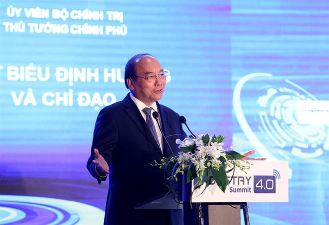 PM Nguyen Xuan Phuc delivers speech at the Industry 4.0 Summit.(Photo: VNA)